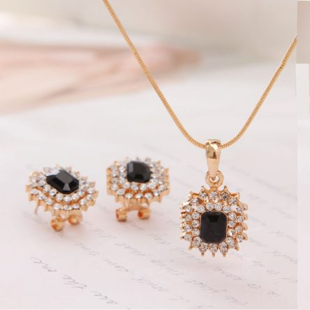 Black Ruby and White Stones Pendant in Yellow Gold